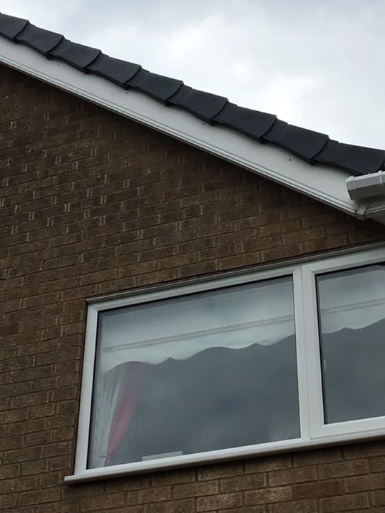 New gutters and new grey dry verge to the gable ends do...
